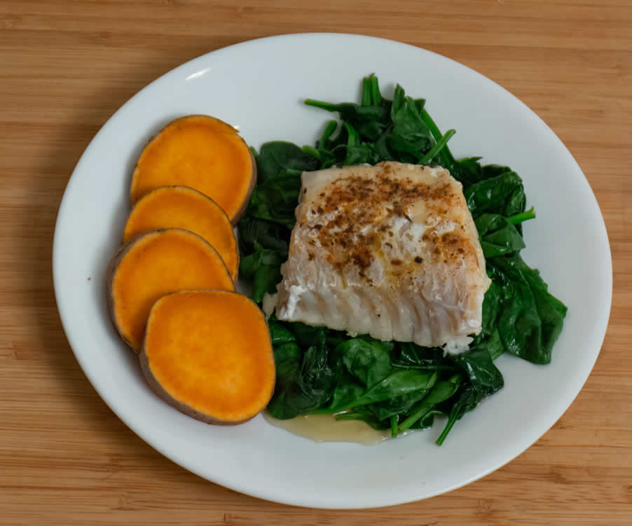 healthy cod on spinach with sweet potato