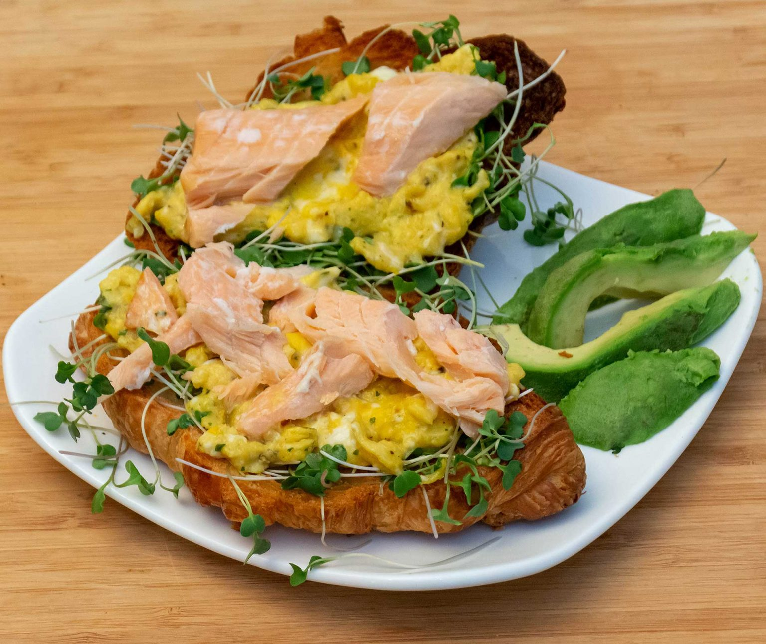 Salmon egg and sprouts on a croissant
